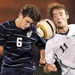Jimmy Forde, left, of St. Ignatius and Amherst's Mark Ferber try to win possession of the ball in the first half. Andrew. DAVID RICHARD / CHRONICLE