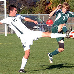 Amherst's No. 14 Marcus Schmitz keeps the ball from Strongsville's No. 3 Brandon Lumsden.