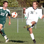 Amherst's No. 36 Josh Birkline clears the ball past Strongsville's No. 20 Drew Shepherd.