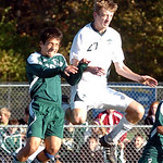 Amherst's No. 27 Jake McDonald heads the ball before Strongsville's No. 16 Mario Suarez.