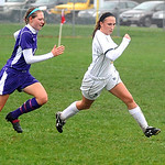 Avon's No. 8 Megan Garner, left,  will fall over Amherst Jessica Sobotka while chasing after ball Oct 19.  Steve Manheim