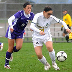 Amherst's No. 10 Brianna Shagovac with eyes covered, and Avon Natalie Wilden in the heavy rain Oct. 19.   Steve Manheim
