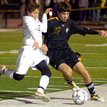 10-27-11 linda murphy</p> <p>Avon&#039;s #22 Daniel Minotti &amp; Amherst&#039;s #17 Dalton Sweet fight for the ball.