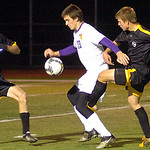 10-27-11 linda murphy</p> <p>Avon&#039;s #23 Ryan Poyle move the  ball past  (left) Amherst&#039;s #27 Jake McDonald &amp; #7 Andrew Souders.