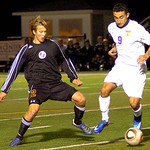 Avon Lake's No. 12 Ryan Schneider and Avon's No. 9 Niko Telidis fight for the ball.