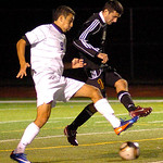 Avon's No. 9 Niko Telidis and Avon Lake's No. 1 Mackenzie Bates fight for the ball.