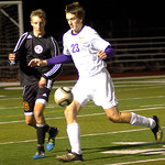 Avon's No. 23 Ryan Pyle tries to work the ball around Avon Lake's No. 16 Jordan Arch.