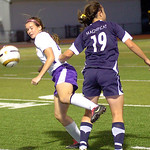 Avon's #11 Leah Yeagley keeps Magnificat's #19 Jillian Grimm from the ball.