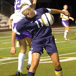 Magnificat's #11 Alexandra Norton and Avon's #22 Regan Betts fight for the header.