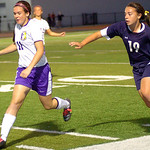 Avon's #11 Leah Yeagley reaches the ball before Magnificat's #19 Jillian Grimm.