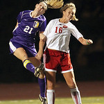 Avon's Hannah Winger heads the ball over Wadswort midfielder Jessica Gearhart during thier Regional Semifinal game at Rocky River. Photo by Aaron Josefczyk