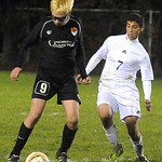 North Olmsted's Benjamin Gebura, left, and Westlak's Omar Salem fight for control of the ball. STEVE MANHEIM/CHRONICLE