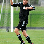 Avon Lake senior defender Patrick Smith heads a ball against North Olmsted. KRISTIN BAUER | CHRONICLE