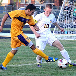 Avon's Christian Giraldo, left, kicks past North Ridgeville's Daniel Knoblauch. STEVE MANHEIM/CHRONICLE