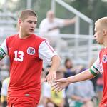 Elyria's Adam Supel, left, congratulates Joshua Lewis on scoring a goal against Keystone.  KRISTIN BAUER | CHRONICLE