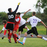 Elyria goalkeeper Carlos Lopez jumps to block a shot on goal by Keystone. KRISTIN BAUER | CHRONICLE