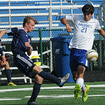 Oberlin's Thomas Protzman kicks past Midview's Chad Eye. STEVE MANHEIM/CHRONICLE