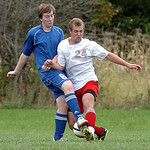 Open Door's John Wallace, left, and First Baptist's Jacob Baker fight for the ball. LINDA MURPHY/CHRONICLE