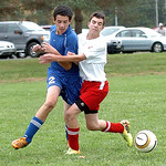 Open Door's Derek Niederhoffer, left, fights for position with First Baptist's Trey Niemeyer. LINDA MURPHY/CHRONICLE