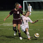 Jenna Ellingston of EC battles Wellington's Janelle Pitts for the ball in EC's District win. photo by Ray Riedel