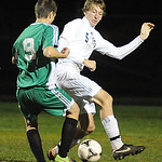 EC 5 Luke Janosik goes up against Columbia 9 Brendan Shields in Div. III district on Oct. 23.  Steve Manheim