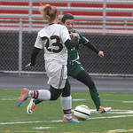 Sara Pallendino scores against Waterloo with this kick at goal; Autumn Davis is #23.