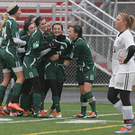 The team congratulates Sara Pallendino (second EC player from the right) after scoring against Waterloo.