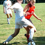 Elyria's #12 Michelle Mariner fights Brookside's #21 Christina Kebeiks for the ball.