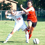Elyria's #10 Sam Silms fights #26 Megan O'Connor for the ball.