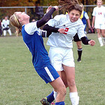 Midview's #5 Kayla Hirschfelder and Elyria's #2 Kayla Yance crash as they go up for a header.