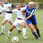 Elyria's #1 Darlan Jones and Midview's #9 Samantha Bauer fight for the ball. Elyria's #12 Michelle Mariner is ready to help.