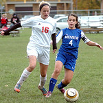 Elyria's #16 Abbey Ramirez fights Midview's #4 Torie Benton for the ball.