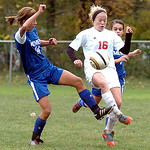 Midview's #14 Morgan Hamker and Elyria's #16 Abbey Ramirez fight for the ball.
