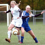 Elyria's #17 Natalie Benko fights Midview's #5 Kayla Hirschfelder for the ball.