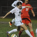 Elyria Catholic's Jenna Ellingson moves the ball past Lutheran West's Molly Szabo. STEVE MANHEIM/CHRONICLE