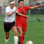 Wellington's Jennifer Echstenkamper goes up against Cuyahoga Heights' Taylor McNeilly. STEVE MANHEIM/CHRONICLE