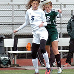 Magnificat Anne Ubbing and Westlake's Rebecca Essig go up for a header. LINDA MURPHY/CHRONICLE
