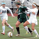 Westlake's Lauren Hurst fights Magnificat's Katherine Viancourt and Sarah Lawrence for the ball. LINDA MURPHY/CHRONICLE