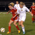 Elyria's Abbey Ramirez, left, and Avon Lake's Karen Krause battle for the ball. LINDA MURPHY/CHRONICLE