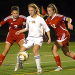 Avon Lake's Emily Peepers keeps the ball from Elyria's Kayla Yance, left, and  Michelle Mariner. LINDA MURPHY/CHRONICLE