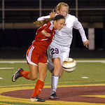 Elyria's Darian Jones, left, and Avon Lake's Olivia Siko fight for the ball. LINDA MURPHY/CHRONICLE