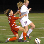 Elyria's Darian Jones, left, tries to keep Avon Lake's Olivia Siko from the ball. LINDA MURPHY/CHRONICLE