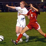 Olmsted Falls' Sherilyn Rogers fights Elyria's Kayla Yance for the ball. LINDA MURPHY/CHRONICLE