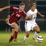 Elyria's Suzie Harjar, left, and Olmsted Falls' Madison Horvath fight for the ball. LINDA MURPHY/CHRONICLE