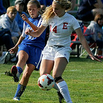 Elyria's Erin Mariner battles for control of the ball with Midview's Colleen Benton. KRISTIN BAUER | CHRONICLE
