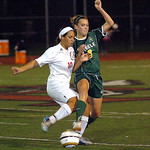 Amherst's Ally Perkins fights Fairview's Paige Strandahl for the ball. Linda Murphy/Chronicle