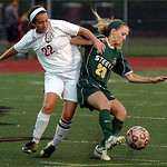 Amherst's Gabrielle Semon keeps Fairview's Katie Kovach away from the ball. Linda Murphy/Chronicle