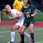 Amherst's Hayley Lepkowski, right, works to keep the ball from Fairview's Mary Lally. Linda Murphy/Chronicle