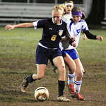 North Ridgeville's 6 Sydney Ramage and Midview Kayla Hirschfelder tangle going for ball Oct. 18. Steve Manheim