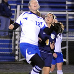 Midview's 12 Katrina Beckloff heads ball nexty to North Ridgeville's Kayla Zingale Oct. 18. Steve Manheim